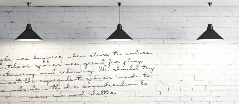 McGuigans wall, white brick wall with writing on it
