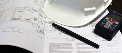 Plans, hard hat and pen